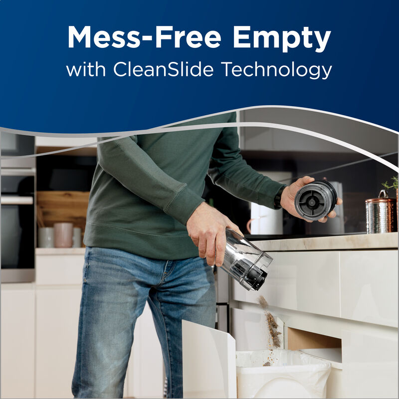 Man emptying dirt tank. Text: Mess-Free empty with CleanSlide Technology.