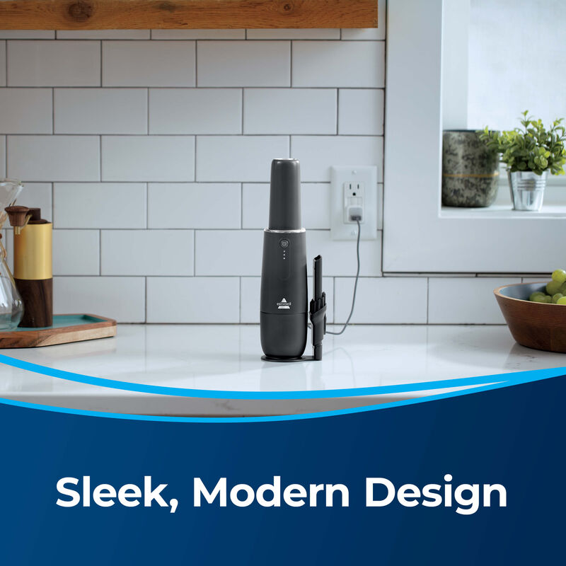BISSELL AeroSlim Hand Vacuum 29869 Image: Charging on Counter Text: Sleek, Modern Design