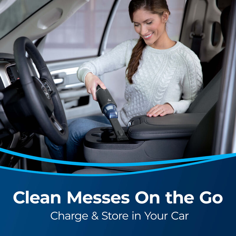 BISSELL AeroSlim Hand Vacuum 29869 Image Vacuuming Auto Interior Text: Clean Messes On the Go. Charge & Store in Your Car.