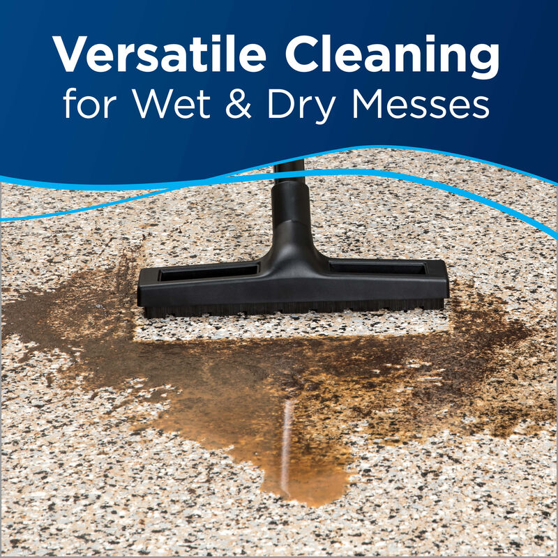 cleaning hard floor with mess Text: versatile Cleaning for wet and dry messes