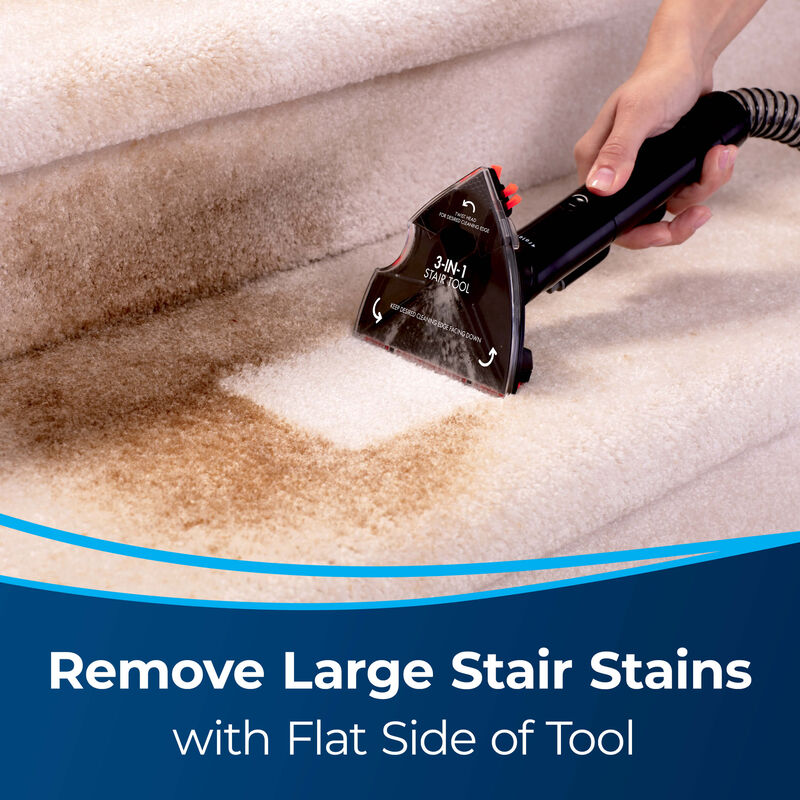 3-in-1 Stair Tool Image of Tool Cleaning Large Stair Stain. Text: Remove Large Stair Stains with Flat Side of Tool