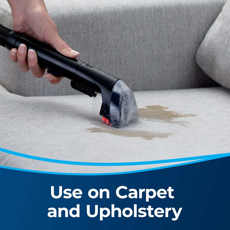 """3"""" Tough Stain Tool 2036651 Use on carpet and upholstery. Person cleaning stain on upholstery"""
