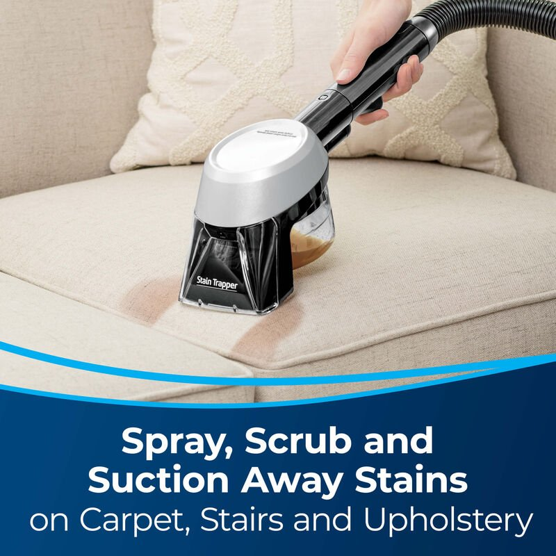 Stain Trapper Tool 1600057 Spray, Scrub and Suction Away Stains on Carpet, Stairs, and Upholstery. Image of tool cleaning couch cushion