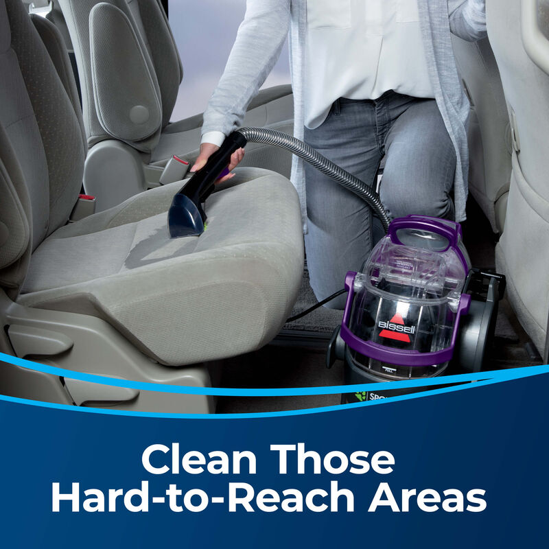 """3"""" Tough Stain Tool 2036651 Clean those hard-to-reach-areas. Person using portable cleaner in car cleaning car seats"""